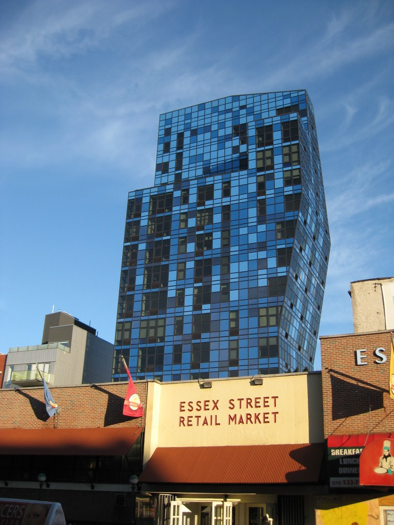 "A symbol of gentrification, the new luxury condominiums of ""Blue"" rise above the 70 year-old Essex Street Market."